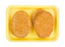 Veal patties on a yellow foam tray Royalty Free Stock Images