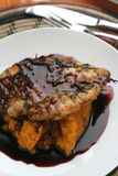 Veal and Red wine sauce. Meat dish with thyme, herbs and red wine sauce, over a creamy pumpkin mash Stock Image