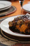 Veal and red wine sauce; close crop tall view Stock Photo