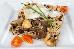 Veal with rice and mushrooms. Stock Photo