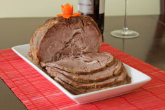 Veal roast. Home made veal roast, cut and server with wine Royalty Free Stock Image