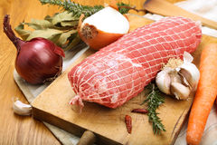 Veal roll ready to cook on a cutting board Royalty Free Stock Images