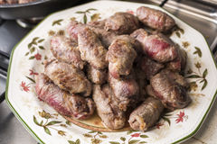 Veal rolls with bacon, cheese and plum Stock Image