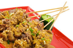 Veal satay 3. Black plate with chicken satay on white royalty free stock photography