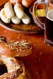 Veal sausage, Pretzels and Beer Stock Images