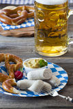 Veal sausage and pretzels Royalty Free Stock Images