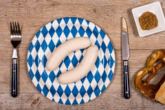 Veal sausages with pretzel and sweet mustard Royalty Free Stock Photos