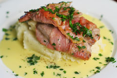 Veal Scallopine, landscape mid portrait. Veal Scallopine wrapped in prosciutto on creamy mash with Beure blanc. Close crop landscape from above Royalty Free Stock Photos