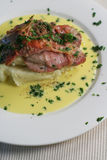 Veal Scallopini with Beure Blanc. Veal Scallopini wrapped in prosciutto on creamy mash with Beure blanc (butter sauce infused with lemon, bay leaves and onion) Royalty Free Stock Photography