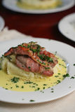 Veal Scallopini, mid portrait. Veal Scallopini wrapped in prosciutto on creamy mash with Beure blanc (butter sauce infused with lemon, bay leaves and onion) Royalty Free Stock Photography
