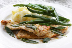 Veal Scaloppini. Panfried with sage leaves.  Served with mashed potatoes and green beans Royalty Free Stock Images