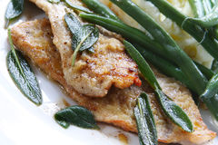 Veal Scaloppini. With sage leaves, served with green beans and mashed potato Royalty Free Stock Photo