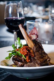 Veal shank. Over prosciutto-roasted potatoes Stock Images