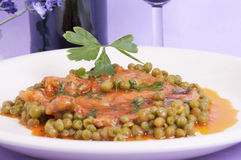 Veal shank with peas and tomato Royalty Free Stock Image