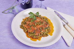 Veal shank with peas and tomato Royalty Free Stock Photography