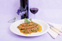 Veal shank with peas and tomato Royalty Free Stock Images