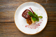 Veal sirloin, mashed potatoes chards and shallots Royalty Free Stock Image