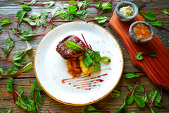 Veal sirloin, mashed potatoes chards and shallots Royalty Free Stock Photo