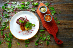 Veal sirloin, mashed potatoes chards and shallots Royalty Free Stock Images