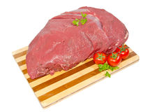 Veal sirloin steaks on a cutting board. Veal sirloin steaks on a wooden chopping board with a white background Stock Photography