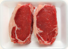 Veal sirloin on tray stock photography