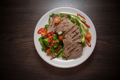 Veal slices with spinach Royalty Free Stock Photos