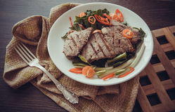 veal with spinach and chilli Stock Photos