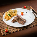 Veal steak with fried vegetables Royalty Free Stock Photo