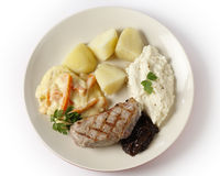 Veal steak with gourmet vegetables from above. Veal sirloin steak with onion marmalade, celeriac puree, julienned carrots in a white sauce and boiled potatoes royalty free stock photography