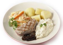 Veal steak with gourmet vegetables side view royalty free stock images