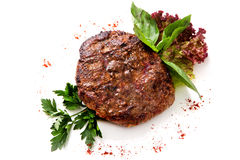 Veal steak with greens and herbs. Served roast fillet mignon with greens and herbs  on White Background Stock Image