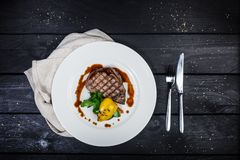 Veal steak with grilled vegetables. stock image