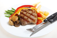 Veal steak meal with cutlery Royalty Free Stock Photography