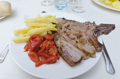 Veal steak in a plate Stock Photos