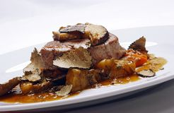 Veal steak with potatoes stock images