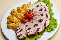 Veal tenderloin stuffed with cherry. Pork tenderloin stuffed with cherries sliced apples Royalty Free Stock Photo