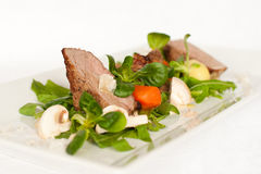 Meat with vegetables. Veal with vegetables and sea salt royalty free stock images