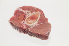 Veal on white background. Raw slice of veal shank on a white background Royalty Free Stock Image