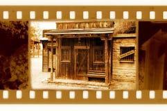 Vecchi 35mm incorniciano la foto con la casa dello sceriffo dell'annata Fotografia Stock Libera da Diritti