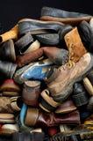 Vecchi ambiti di provenienza 4 delle scarpe Fotografia Stock