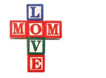 Vecchi blocchi impilati per leggere la mamma di amore Fotografia Stock