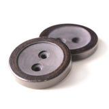 Vecchi bottoni neri isolati su fondo bianco Immagine Stock