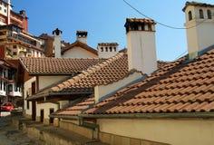 Vecchi case e tetti con le mattonelle di ceramica Immagini Stock Libere da Diritti