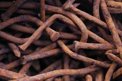 Vecchi chiodi arrugginiti Fotografie Stock