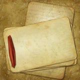 Vecchi documenti di Grunge per il disegno con il nastro rosso Fotografia Stock Libera da Diritti