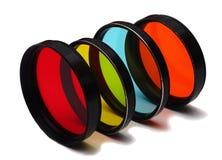 Vecchi filtri dalla foto a colori su fondo bianco Fotografie Stock