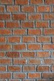 Vecchi fondo e struttura di pietra arancio del mattone Immagini Stock