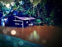Vecchi garage ed inondazione Fotografie Stock