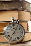 Vecchi libri e cronometro Immagini Stock Libere da Diritti