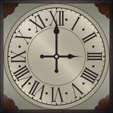 Vecchi orologi di parete con i numeri romani Immagine Stock